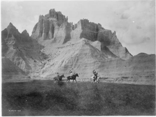 Entering the badlands. 3 Lakota Sioux  on horseback