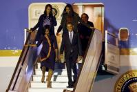 U.S. President Obama and First Lady Michelle arrive for their visit to Argentina at Buenos Aires' international airport