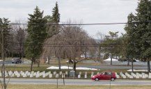 A car drives by Indian Cemetery on Claremont Road in Carlisle. The Rosebud Sioux in South Dakota have begun efforts to repatriate the remains of the 10 Rosebud students buried in the Carlisle Indian School Cemetery. CHARLES FOX / Staff Photographer