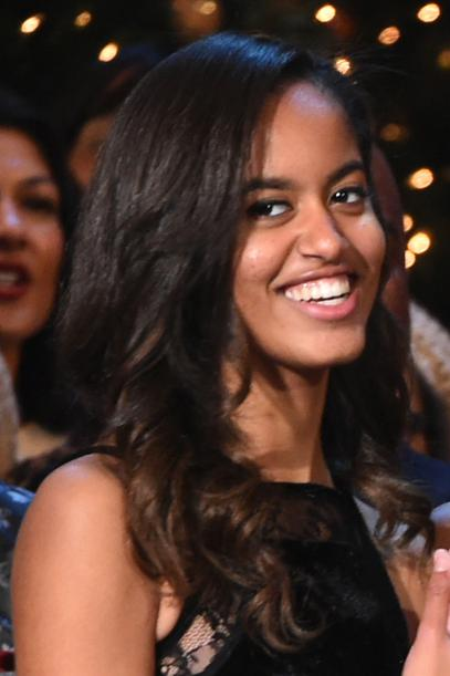 WASHINGTON, DC - DECEMBER 14: Malia Obama and Sasha Obama speak onstage at TNT Christmas in Washington 2014 at the National Building Museum on December 14, 2014 in Washington, DC.  25248_001_0582.JPG  (Photo by Theo Wargo/WireImage)