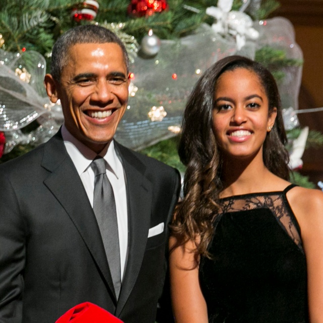 "WASHINGTON, DC - DECEMBER 14: (AFP OUT) U.S. President Barack Obama (C, R), first lady Michelle Obama (L) and daughters Sasha (C,L) and Malia (R) pose with ""elves"" prior to the taping of TNT's ""Christmas in Washington"" program on December 14, 2014 in Washington, DC. The ""elves"" are former patients of Children's National Medical Center, the beneficiary of this evenings concert. (Photo by Kristoffer Tripplaar-Pool/Getty Images)"