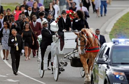 The funeral procession for Philando Castile approaches the Cathedral of St. Paul where services will take place in St. Paul, Minnesota, July 14, 2016. REUTERS/Eric Miller