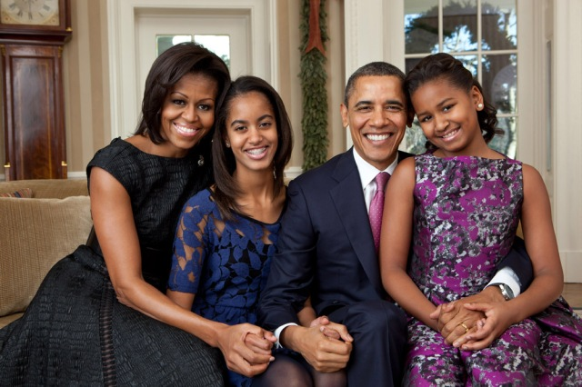 President Barack Obama, First Lady Michelle Obama, and their daughters, Sasha and Malia, sit for a family portrait in the Oval Office, Dec. 11, 2011. (Official White House Photo by Pete Souza) The attached photo is embargoed until 10am, Dec. 15, 2011, and is provided by THE WHITE HOUSE as a courtesy for use only by online media outlets. This photograph may not be distributed to other media outlets. This photograph may not be manipulated in any way and may not otherwise be reproduced, disseminated, broadcast, or archived, without the written permission of the White House Photo Office. This photograph may not be used in any commercial or political materials, advertisements, emails, products, promotions that in any way suggests approval or endorsement of the President, the First Family, or the White House.
