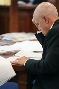 Assistant Prosecutor Mark Piepmeier reads over the transcript of Cincinnati Police interviewing Ray Tensing in the courtroom of Common Pleas Judge Megan Shanahan at the Hamilton County Courthouse, Thursday, Nov. 3, 2016, in Cincinnati. Tensing, a former University of Cincinnati police officer, is charged with fatally shooting Sam DuBose during a routine traffic stop in July 2015. (Cara Owsley/The Cincinnati Enquirer via AP, Pool)