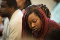 Tues., Nov. 1, 2016: Sam Dubose's daughters Raegan Brooks, right, looks at Ray Tensing's family during opening statements on the first day the jury heard the murder trial of Ray Tensing in the death of Sam DuBose. The Enquirer/Carrie Cochran Tensing, the former University of Cincinnati police officer is charged with murder in the shooting death of Sam DuBose. His attorney Stew Mathews has said Tensing fired a single shot because he feared for his life.