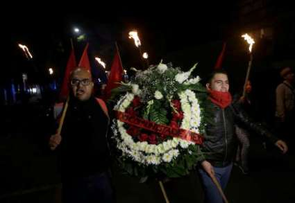 Activists and members of the Communist Party of Mexico carry a flower wreath along the streets as part of a tribute, following the announcement of the death of Cuban revolutionary leader Fidel Castro, in Mexico City