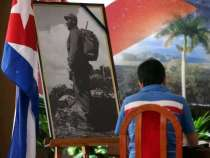 A man signs condolences to late Cuban revolutionary leader Fidel Castro inside the Cuban Embassy in Buenos Aires, in Buenos Aires, Argentina