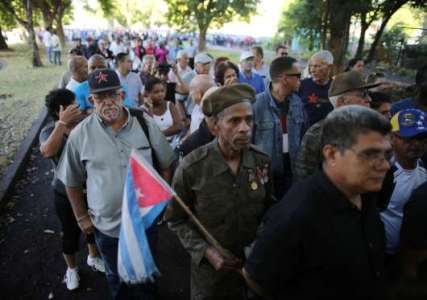 People stand in line to pay tribute to Cuba's late President Fidel Castro in Revolution Square in Havana