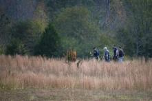 Police search a field on property owned by Todd Kohlhepp