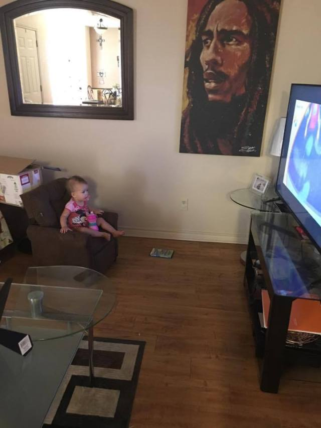 parker-watching-tv-in-her-own-chair-with-sippy-cup