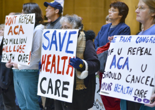 People attend a health care rally at the Indiana Statehouse in support of the Affordable Care Act, Sunday, Jan. 15, 2017, in Indianapolis