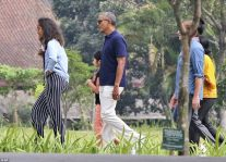 Former US President Barack Obama, center, walks with his daughter Malia, left, during his visit to Prambanan Temple in Java Read more: http://www.dailymail.co.uk/news/article-4649902/Obama-waves-performs-traditional-Hindi-greeting.html#ixzz4lYIPc2tS Follow us: @MailOnline on Twitter | DailyMail on Facebook