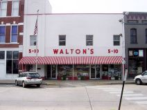 A salesman named Sam Walton opened a store in 1962 called Walton's Five-and-Dime. He'd eventually build his way to fame and fortune through controversial means, and establish the now infamous Wal-Mart brand.