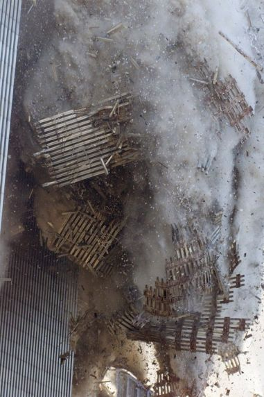 The south tower of New York's World Trade Center collapses Tuesday, Sept. (AP Photo/Richard Drew) # I still remember what I was doing this is a powerful picture The Facade Falls The latticework facing of the south tower came tumbling to earth upon impact of the hijacked plane. Photo: Richard Drew/AP Wide World Photos