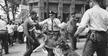 A 17-year-old, Walter Gadsden, civil rights demonstrator is attacked by a police dog on May 3, 1963, Birmingham, Alabama. AP/BILL HUDSON
