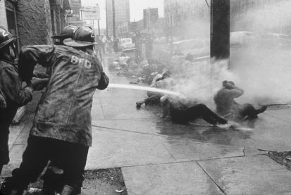 Charles Moore, Firemen Use High-Pressure Hoses against Protestors, Birmingham, Alabama, May 1963 Birmingham, Alabama, Civil rights protesters getting hosed. Human beings (left) trying to stop more human beings (right) from demanding to be treated like human beings, 1963