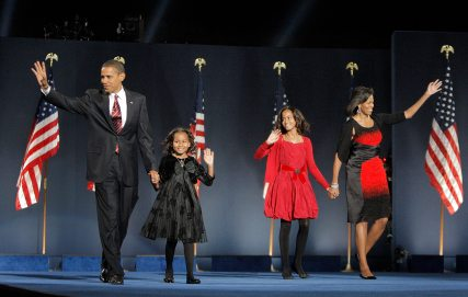 In this Nov. 4, 2008, file photo, then-President-elect Barack Obama, left, his wife Michelle Obama, right, and daughters, Malia, and Sasha, second from left, wave to the crowd at the election night rally in Chicago. (AP Photo/Jae C. Hong)