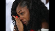 Myeshia Johnson wipes away tears during the burial service for her husband U.S. Army Sgt. La David Johnson at the Memorial Gardens East cemetery on October 21, 2017 in Hollywood, Florida. Sgt. Johnson and three other American soldiers were killed in an ambush in Niger on Oct. 4. (Photo by Joe Raedle/Getty Images)