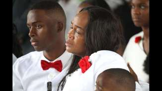 Richard Johnson, Jr and Cowanda Jones-Johnson attend the burial service for her son U.S. Army #SgtLaDavidJohnson