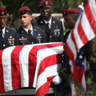U.S. Military honor guards carry the casket of U.S. Army Sgt. La David Johnson during his burial service at the Memorial Gardens East cemetery on October 21, 2017 in Hollywood, Fla. JOE RAEDLE/GETTY IMAGES