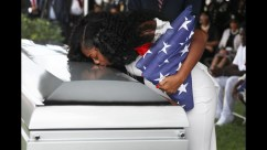 Myeshia Johnson, wife of U.S. Army Sergeant La David Johnson, who was among four special forces soldiers killed in Niger, kisses his coffin at a graveside service in Hollywood, Fla. (JOE SKIPPER/REUTERS)
