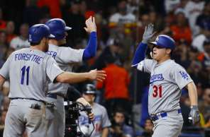 Los Angeles Dodgers center fielder Joc Pederson (31) celebrates his three-run home run in the ninth inning off of Joe Musgrove during Game 4 of the World Series at Minute Maid Park on Saturday, Oct. 28, 2017, in Houston.