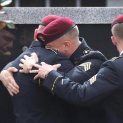 Members of the 3rd Special Forces Group (Airborne) 2nd battalion Fse comfort each other at services for U.S. Army #SgtLaDavidJohnson