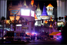 Las Vegas Metro Police and medical workers stage in the intersection of Tropicana Avenue and Las Vegas Boulevard South after a mass shooting at a music festival on the Las Vegas Strip. CREDIT: REUTERS