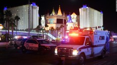 An ambulance leaves the intersection of Las Vegas Boulevard and Tropicana Ave. after a mass shooting at a country music festival nearby on October 2, 2017 in Las Vegas, Nevada. A gunman has opened fire on a music festival in Las Vegas, leaving at least 20 people dead and more than 100 injured. Police have confirmed that one suspect has been shot. The investigation is ongoing. (Photo by Ethan Miller/Getty Images)