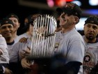 Houston Astros manager A.J. Hinch holds the championship trophy after Game 7 of baseball's World Series against the Los Angeles Dodgers Wednesday, Nov. 1, 2017, in Los Angeles. The Astros won 5-1 to win the series 4-3. (AP Photo/Matt Slocum)