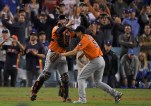 Houston Astros catcher Brian McCann and starting pitcher Charlie Morton celebrate after win against the Los Angeles Dodgers in Game 7 of baseball's World Series Wednesday, Nov. 1, 2017, in Los Angeles. (AP Photo/Mark J. Terrill)