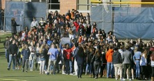 Students from Douglas Freeman High School walk out of school to protest gun violence in Richmond, Va., Wednesday, March 14, 2018. Young people in the U.S. walked out of school to demand action on gun violence Wednesday in what activists hoped would be the biggest demonstration of student activism yet in response to last month's massacre in Florida. (AP Photo/Steve Helber)