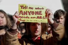 A student from Fiorello H. Laguardia High School holds a sign in support of the National School Walkout in the Manhattan borough of New York City, New York, U.S., March 14, 2018. REUTERS/Mike Segar - RC1D1EA73360