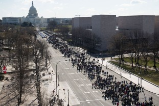 Thousands of local students march down Pennsylvania Avenue to the US Capitol during a nationwide student walkout for gun control in Washington, DC, March 14, 2018. Students across the US walked out of classes on March 14, in a nationwide call for action against gun violence following the shooting deaths last month at a Florida high school. The nationwide protest is being held one month to the day after Nikolas Cruz, a troubled 19-year-old former student at Stoneman Douglas, unleashed a hail of gunfire on his former classmates. / AFP PHOTO / SAUL LOEB (Photo credit should read SAUL LOEB/AFP/Getty Images)