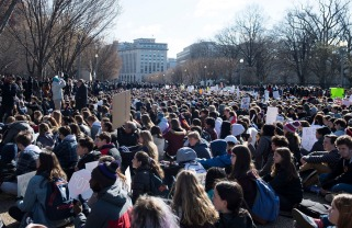 Thousands of local students sit for 17 minutes in honor of the 17 students killed last month in a high school shooting in Florida, during a nationwide student walkout for gun control in front the White House in Washington, DC, March 14, 2018. Students across the US walked out of classes on March 14, in a nationwide call for action against gun violence following the shooting deaths last month at a Florida high school. The nationwide protest is being held one month to the day after Nikolas Cruz, a troubled 19-year-old former student at Stoneman Douglas, unleashed a hail of gunfire on his former classmates. / AFP PHOTO / SAUL LOEB (Photo credit should read SAUL LOEB/AFP/Getty Images)