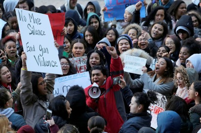Brandon Gonzalez, 16, leads fellow students in protest during a class walkout from the Richard R. Green High School of Teaching while participating in the National School Walkout in Manhattan, New York City, U.S., March 14, 2018. REUTERS/Andrew Kelly - RC1DB7F23690