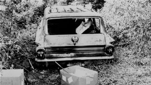 "June 24, 1964, photo shows the burned station wagon of Michael Schwerner, Andrew Goodman and James Chaney in a swampy area near Philadelphia, Miss. The bodies of the men were found later in an earthen dam. Their deaths inspired the 1988 movie ""Mississippi Burning"""