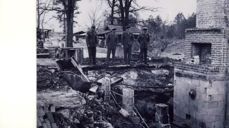 Four sons of Vernon Dahmer, who was murdered for offering to pay poll taxes for those who couldn't afford the fee required to vote,dressed in their military uniforms & overlooking the rubble of the family home. (Six of his seven sons served in the armed forces a total of 78 years