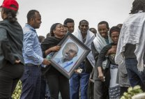 Ethiopian relatives of crash victims mourn and grieve at the scene where the Ethiopian Airlines Boeing 737 Max 8 crashed shortly after takeoff on Sunday killing all 157 on board, near Bishoftu, south-east of Addis Ababa, in Ethiopia Thursday, March 14, 2019. The French air accident investigation authority said Thursday that it will handle the analysis of the black boxes retrieved from the crash site and they have already arrived in France but gave no time frame on how long the analysis could take. (AP Photo/Mulugeta Ayene)