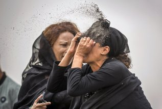 A relative puts soil on her face as she mourns at the scene of the Ethiopian Airlines Flight ET 302 plane crash, near the town Bishoftu, near Addis Ababa, Ethiopia, March 14. REUTERS/Tiksa Negeri